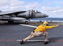 A Sailor Directs an AV-8B Harrier