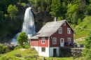 Traditional House and Waterfall in Norway