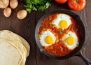 Shakshuka With Eggs, Tomato and Parsley