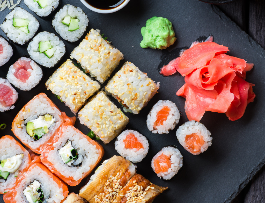 Sushi served on black stone jigsaw puzzle in food bakery for Sashimi fish crossword