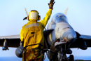 Navy Sailor Directing an F-18 Hornet