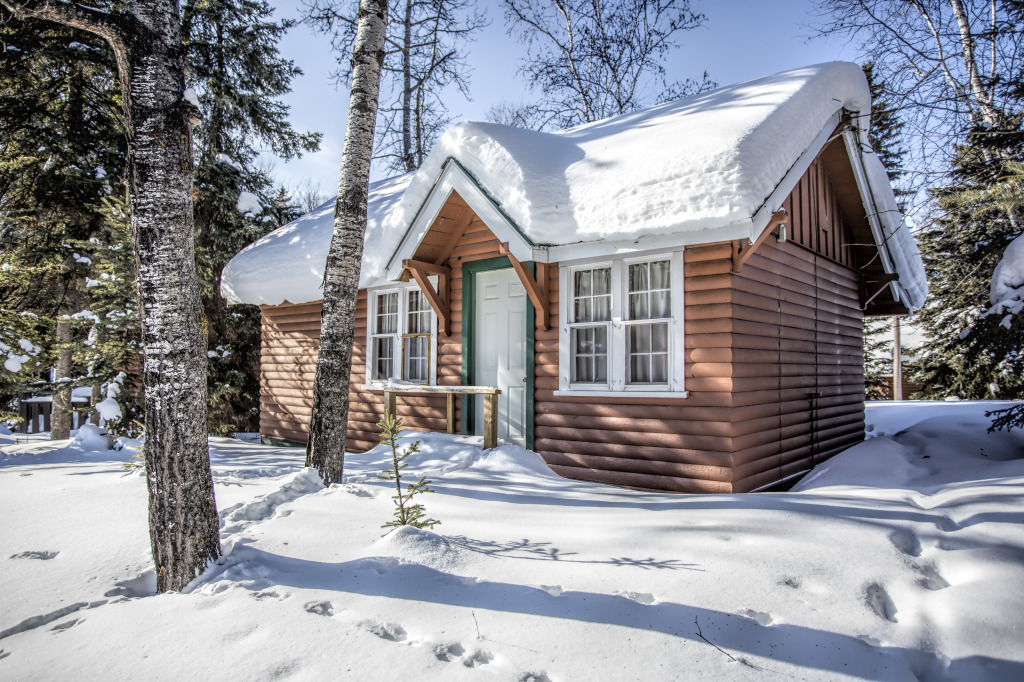 Snow covered log cabin jigsaw puzzle in of the day