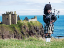 Scottish Bagpiper near Dunnottar Castle