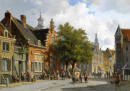 Figures in the Sunlit Streets of a Dutch Town