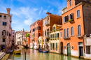 Narrow Canal with Gondolas in Venice