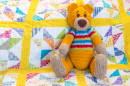 Teddy Bear on a Quilted Duvet Cover
