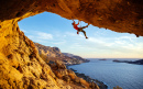 Climber on an Overhanging Rock