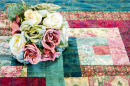 Silk Flowers on a Vintage Quilt