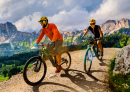 Couple Cycling in Dolomite Alps